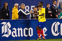 Jaime Ayovi (17) of Ecuador celebrates scoring with head coach: Reinaldo Rueda. Ecuador defeated Chile 3-0 during an international friendly at Citi Field in Flushing, NY, on August 15, 2012.