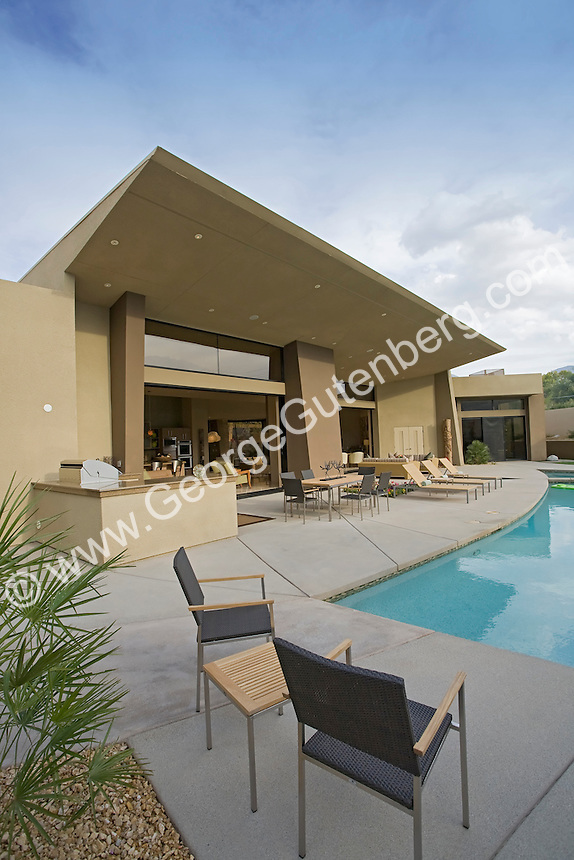 Stock photo of residential swimming pool and patio