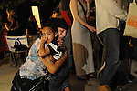 ATLANTA, Georgia - September  21, 2011: After the announcement that Troy Davis' execution will be moving forward Ariana Lima hugs her son Zion &quot;in fear,&quot; she said, &quot;that this is the world that Zion will be inheriting.&quot;<br /> <br /> More photos from the vigil here:<br /> http://tinyurl.com/3rvhwhs<br /> <br /> It was a roller coaster of emotions last night at the Georgia Capitol. Hundreds of Troy Davis supporters gathered for a vigil with a glimmer of hope that Davis would be granted clemency before his execution, which was scheduled to take place at 7 p.m. at the Georgia Diagnostic and Classification Prison in Butts County. Supporters braced themselves for the announcement of his execution. But by 7:05 p.m., rumors began to spread that Davis had been granted a stay. Hours passed with no announcement as to Davis' fate and the crowd at the Capitol started to think that his life might be spared. Those hopes were crushed when it was announced around 10:30 p.m. that Davis' execution by the state would move forward.