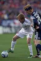 DC United midfielder Dax McCarty (10) holds off defender New England Revolution midfielder Pat Phelan (28). In a Major League Soccer (MLS) match, the New England Revolution defeated DC United, 2-1, at Gillette Stadium on March 26, 2011.