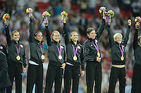 London, England - Thursday, August 9, 2012: The USA defeated Japan 2-1 to win the London 2012 Olympic gold medal at Wembley Arena. The USA waves to the crowd after receiving their gold medals. .