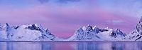 Scenic winter view across Kjerkfjorden towards Vindstad, near Reine, Lofoten islands, Norway