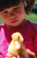 Girl with duckling