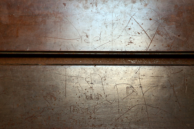 I didn't notice the writing on the front of my husband's dresser for 12 years. As boys growing up in the same bedroom, he and his twin brother carved their names multiple times in the wood. The dresser's status as a family heirloom, formerly their grandparents', did not faze them. The writings' invisibility seems fitting for the way we forget what we did and felt as a child.