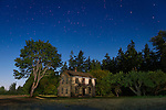 The old, now-empty Knutson farmhouse along Old Olympic Highway near the river, lit by the moon. (John Knutson 1853-1925) Sequim WA