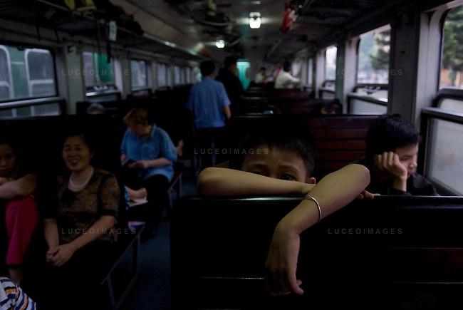passengers ride the train from Hanoi to Sapa, Vietnam.