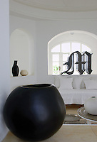"There are interesting objects everywhere; in the foreground a ceramic piece from the Belart atelier and in the far alcove a metal sculpture in the form of the letter ""M"" by Paolo Perrelli"