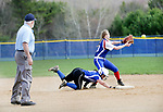 Burlington, CT- 17 April 2017-041717CM07-  Lewis Mills' Amiee Carrier slides safely back to second ahead of the throw to Nonnewau'g Heather Abramovich during their Berkshire League matchup in Burlington on Monday.  Nonnewaug would take home the win, 5-1.   Christopher Massa Republican-American