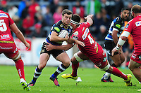 George Ford of Bath Rugby takes on the Scarlets defence. Pre-season friendly match, between the Scarlets and Bath Rugby on August 20, 2016 at Eirias Park in Colwyn Bay, Wales. Photo by: Patrick Khachfe / Onside Images
