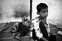 Children sleep on the floor in open air outside the Technical College building temporarely housing flood victims. Karachi, Pakistan, 2010