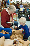 """Berkeley CA Grandmother helping grandson, four-years-old, build with construction toy during school """"Grandparents' Day"""""""