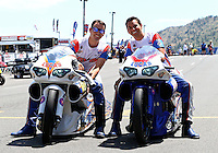Jul. 21, 2013; Morrison, CO, USA: NHRA brothers and pro stock motorcycle riders Adam Arana (left) and Hector Arana Jr during the Mile High Nationals at Bandimere Speedway. Mandatory Credit: Mark J. Rebilas-