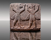 "Picture of Neo-Hittite orthostat describing the legend of Gilgamesh from Karkamis,, Turkey. Museum of Anatolian Civilisations, Ankara.Symetrical mythological Scene depicting ""Winged Griffin Demons"", half men with birds heads & wings. Their hands are raised above their heads supposidly carrying the sky. 4"