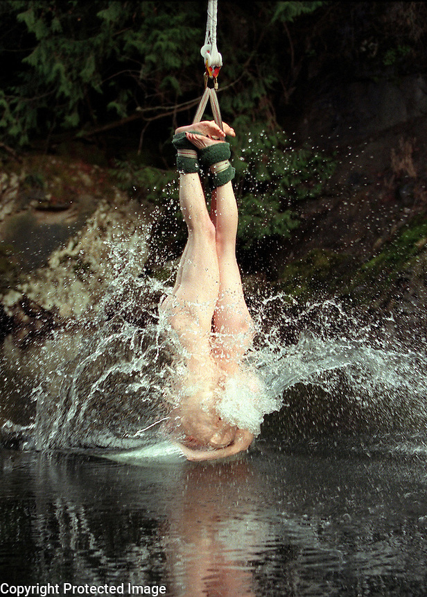 The ultimate in togetherness, Kirstin Larson and Alex Frix of Seattle take the big plunge, that is, into the Nanaimo River, during a naked bungy jumping day at the Bungy Zone in Nanaimo, B.C. on February 14, 2001.