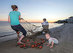 Three generations of Wakulla County mullet fishermen make a strike at the beginning of the 2016 roe mullet run at Shell Point Beach in the Florida panhandle.