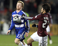 Dax McCarty#13 of FC Dallas pushes the ball ahead of Kosuke Kimura#27 of the Colorado Rapids during MLS Cup 2010 at BMO Stadium in Toronto, Ontario on November 21 2010. Colorado won 2-1 in overtime.