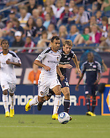 Los Angeles Galaxy midfielder Juninho (19) brings the ball forward as New England Revolution midfielder Jason Griffiths (16) closes. The New England Revolution defeated LA Galaxy, 2-0, at Gillette Stadium on July 10, 2010.