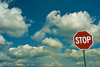 Red Stop Sign, White Letters, Blue Sky, Clouds