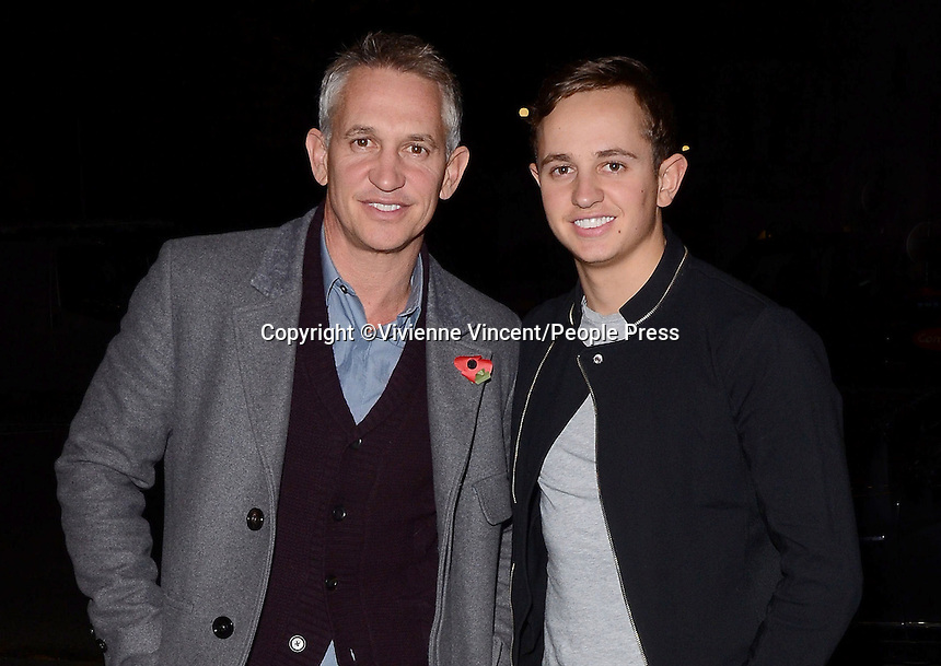 Gary Lineker arrives at the Playhouse Theatre with son George to see Spamalot on the week he is playing God in the show on November 4th 2013<br /> <br /> Photo by Vivienne Vincent
