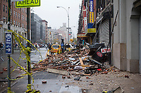 Debris from the collapse of a facade of a building in Chelsea torn off during Hurricane Sandy seen on Tuesday, October 30, 2012. Hurricane Sandy roared into New York disrupting the transit system and causing widespread power outages. Con Edison is estimating it will take four days to get electricity back to Lower Manhattan. (© Frances M. Roberts)