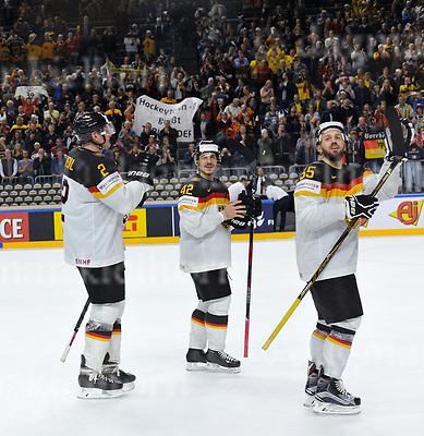 Friday, 5 May, 2017,Lanxess Arena , Cologne/GER<br /> IIHF World Hockey Championship 2017<br /> USA  vs  GER<br /> L-r:Denis Reul ,Yasin Ehliz , Felix Sch&uuml;tz celebrate with fans 2:1 vs USAFriday, 5 May, 2017,Lanxess Arena , Cologne/GER<br /> IIHF World Hockey Championship 2017<br /> USA  vs  GER