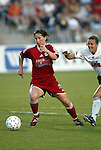 19 June 2003: Maren Meinert (left) of Germany and the Boston Breakers pulls away from Brandi Chastain (right) of the San Jose CyberRays. The WUSA World Stars defeated the WUSA American Stars 3-2 in the WUSA All-Star Game held at SAS Stadium in Cary, NC.
