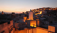 Evening view over the rooftops of the medina or old town of Tetouan, on the slopes of Jbel Dersa in the Rif Mountains of Northern Morocco. Tetouan was of particular importance in the Islamic period from the 8th century, when it served as the main point of contact between Morocco and Andalusia. After the Reconquest, the town was rebuilt by Andalusian refugees who had been expelled by the Spanish. The medina of Tetouan dates to the 16th century and was declared a UNESCO World Heritage Site in 1997. Picture by Manuel Cohen