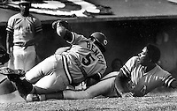 Oakland A's pitcher John &quot;Blue Moon&quot; Odom is tagged out at home by Cincinnati Reds catcher Johnny Bench.<br />
