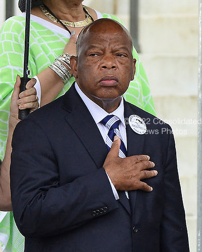 United States Representative John Lewis (Democrat of Georgia), the last surviving speaker at the March in 1963, listens to the National Anthem at the Let Freedom Ring ceremony on the steps of the Lincoln Memorial to commemorate the 50th Anniversary of the March on Washington for Jobs and Freedom<br /> Credit: Ron Sachs / CNP