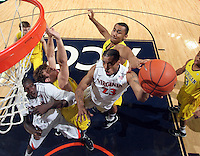 CHARLOTTESVILLE, VA- NOVEMBER 29: Mike Scott #23 of the Virginia Cavaliers shoots the ball surrounded by Michigan Wolverine defenders during the game on November 29, 2011 at the John Paul Jones Arena in Charlottesville, Virginia. Virginia defeated Michigan 70-58. (Photo by Andrew Shurtleff/Getty Images) *** Local Caption *** Mike Scott