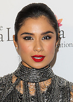 HOLLYWOOD, LOS ANGELES, CA, USA - OCTOBER 09: Diane Guerrero arrives at the Eva Longoria Foundation Dinner held at Beso Restaurant on October 9, 2014 in Hollywood, Los Angeles, California, United States. (Photo by Celebrity Monitor)