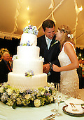 Henry and Jenna Hager pause as they cut their wedding cake Saturday, May 10, 2008, during a reception in their honor following the ceremony at Prairie Chape Ranch near Crawford, Texas. .Mandatory Credit: Shealah Craighead / White House via CNP.