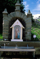 Caraquet, NB, New Brunswick, Canada - a Small Shrine with a Statue of the Virgin Mary and Sainte Anne, and a Fountain with Spring Water for drinking, at Sainte-Anne-du-Bocage, a Catholic Sanctuary