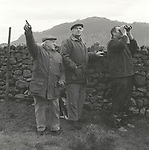 The Blencathra Foxhounds.  Hunt supporters follow the hounds from their vehicles as they stream across the mountainous terrain. Near Braithwaite, Cumbria...Hunting with Hounds / Mansion Editions (isbn 0-9542233-1-4) copyright Homer Sykes. +44 (0) 20-8542-7083. < www.mansioneditions.com >..