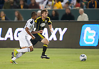 Columbus Crew midfielder Eddie Gaven (12) and LA Galaxy defender Sean Franklin (28) race to the ball during the first half of the game between LA Galaxy and the Columbus Crew at the Home Depot Center in Carson, CA, on September 11, 2010. LA Galaxy 3, Columbus Crew 1.