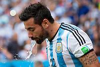 Ezequiel Lavezzi of Argentina spits out water