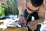A drug named Kei, 29, mixes his fix of morphine mixed with cocaine and synthetic heroin before injecting it into his arm in a vacant lot along Mason Street in Victoria, B.C. The vacant lot, littered with garbage and used needles, is a common site for intravenous drug users to utilize as a shooting gallery. Photo shot for the GLOBE and MAIL.