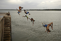 Boys jump into the sea in S&atilde;o Jos&eacute; do Ribamar, Maranh&atilde;o state, Brazil.