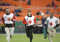 Happy Red Cross crew of D.C. United come to the assistance of an injured player during a US Open Cup match against F.C. Dallas on April 28 2010, at RFK Stadium in Washington D.C. United won 4-2.