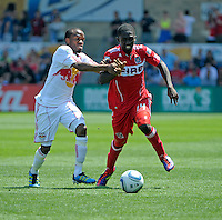 New York midfielder Dane Richards (19) attempts to slow down Chicago midfielder Patrick Nyarko (14).  The Chicago Fire tied the New York Red Bulls 1-1 at Toyota Park in Bridgeview, IL on June 26, 2011.