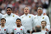 Mako Vunipola, Mike Brown and Dylan Hartley of England sing the national anthem. RBS Six Nations match between England and Scotland on March 11, 2017 at Twickenham Stadium in London, England. Photo by: Patrick Khachfe / Onside Images