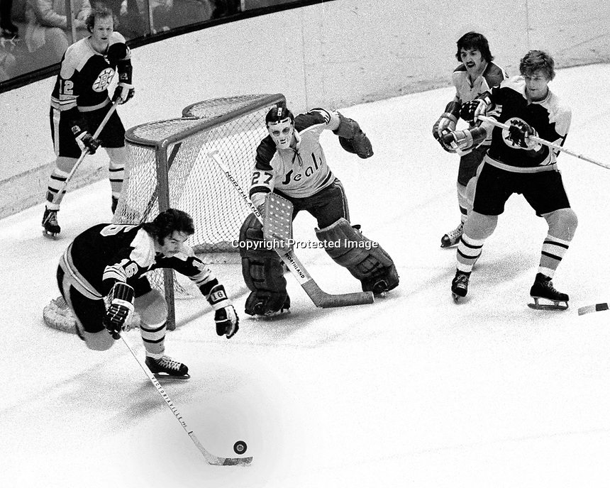Seals vs Boston:Seals goalie Giles Meloche and Carol Vadnais defend against Bruins Wayne Cashman, Derek Sanderson and Bobby Orr...(photo by Ron Riesterer)