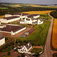 Scotland.  Speyside. Auchroisk Whisky Distillery.  Modern reconstruction in the local style. Aerial.