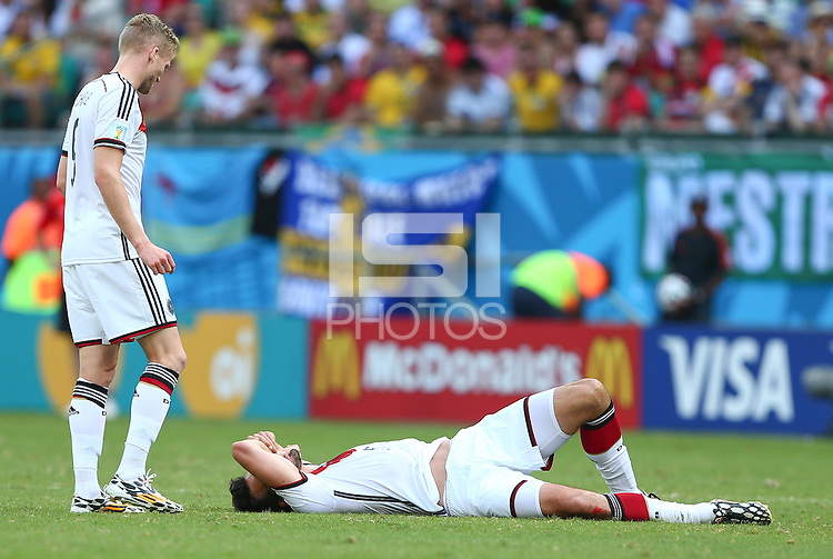 Mats Hummels of Germany lies injured before being substituted