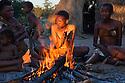 Botswana, Kalahari, bushman (San) women and children gathered around fire