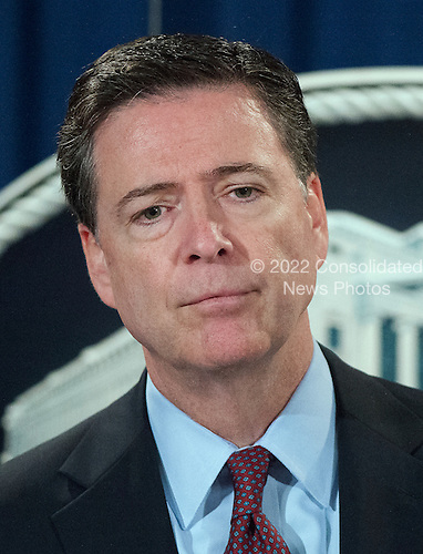 FBI Director James Comey listens to a reporter's question during a press conference at the Department of Justice in Washington, DC on Thursday, March 24, 2016.  It was announced that criminal charges were filed against seven individuals working on behalf of the Iranian government for conducting cyber attacks against the US financial sector and the Bowman Dam in Rye, NY.<br /> Credit: Ron Sachs / CNP<br /> (RESTRICTION: NO New York or New Jersey Newspapers or newspapers within a 75 mile radius of New York City)