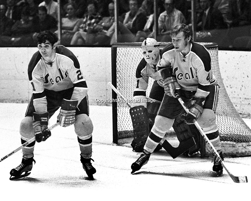 Seals Ron Stackhouse and Dick Redmond guard with goalie Gary Smith...(1971 photo/Ron Riesterer)