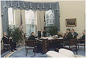 United States President George H.W. Bush, center, meets with (from left to right) Deputy National Security Advisor Robert Gates; US Secretary of Defense Dick Cheney; Chairman of the Joint Chiefs of Staff, US Army General Colin Powell;  White House Chief of Staff John H. Sununu; and US National Security Advisor General Brent Scowcroft in the Oval Office of the White House in Washington, DC on January 18, 1991.<br />