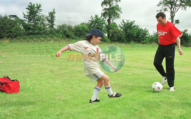 Caoimhe Nelis Kicking Ball with Bill Jackson of Coca COcal Atlantic at the Drogheda Boys ?..Pic: Fran Caffrey / Newsfile