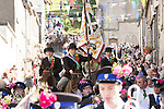Langholm Common Riding 2016, Cornet Simon Tweddle and his left and right hand men beside him makes his way through the crowds down Kirk Wynd